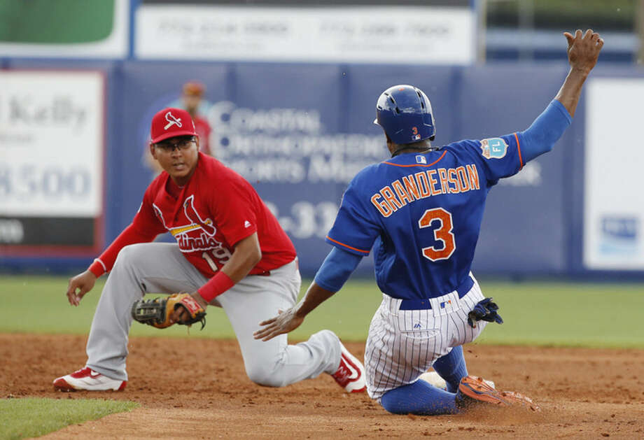 St. Louis Cardinals' shortstop Ruben Tejada tags out stealing New York Mets' Curtis Granderson during the third inning of an exhibition spring training baseball game, Friday, March 25, 2016, in Port St. Lucie, Fla. (AP Photo/Brynn Anderson)