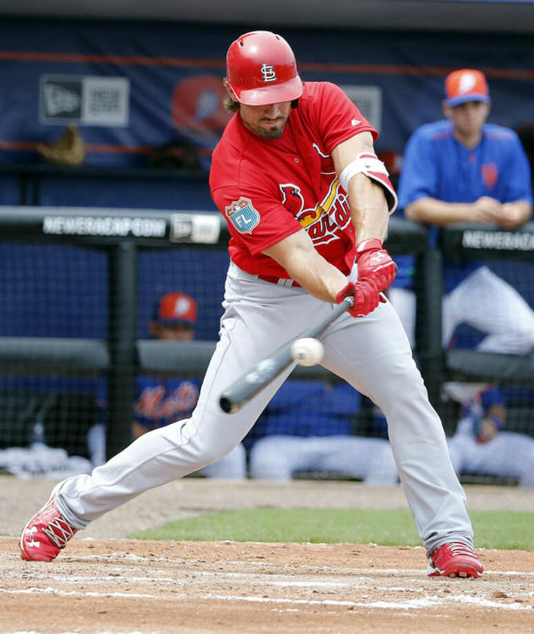 St. Louis Cardinals' Randal Grichuk hits the ball during the second inning of an exhibition spring training baseball game against the New York Mets, Friday, March 25, 2016, in Port St. Lucie, Fla. (AP Photo/Brynn Anderson)