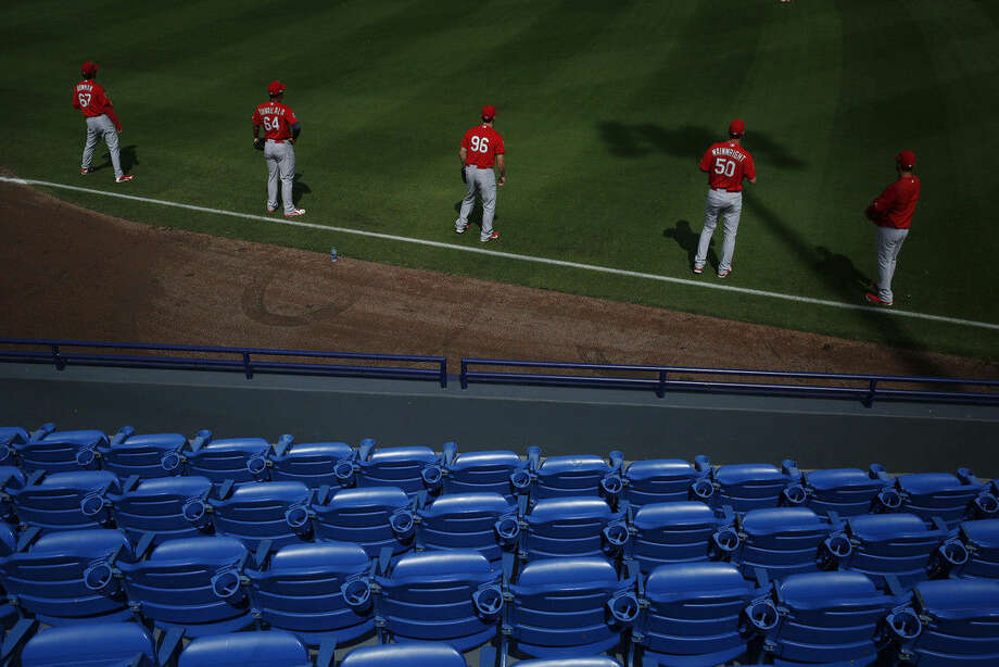 St. Louis Cardinals practice throwing before an exhibition spring training baseball game against the New York Mets, Friday, March 25, 2016, in Port St. Lucie, Fla. (AP Photo/Brynn Anderson)