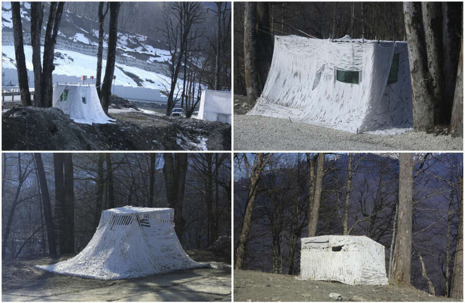This combination of photos taken on Sunday, Feb. 16, 2014, shows white security guard tents along the route between the coastal city of Sochi, Russia, and the mountain village of Krasnaya Polyana, where the Alpine and Nordic events for the 2014 Winter Olympics are taking place. The tents would have been well camouflaged in a snowy environment, but the warm weather has left them exposed against the brown background. (AP Photo/Steve Barker)