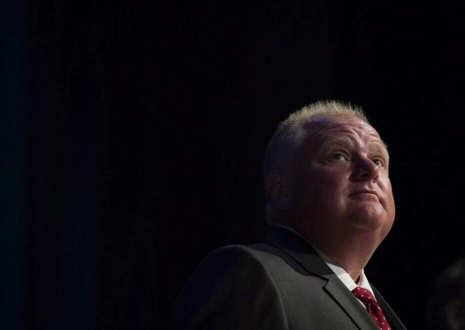 FILE - In this July 15, 2014 file photo, Mayor Rob Ford pauses while participating in a mayoral debate in Toronto. Ford, whose career crashed in a drug-driven, obscenity-laced debacle, died Tuesday, March 22, 2016 after fighting cancer, his family says. He was 46. (Darren Calabrese /The Canadian Press via AP) MANDATORY CREDIT