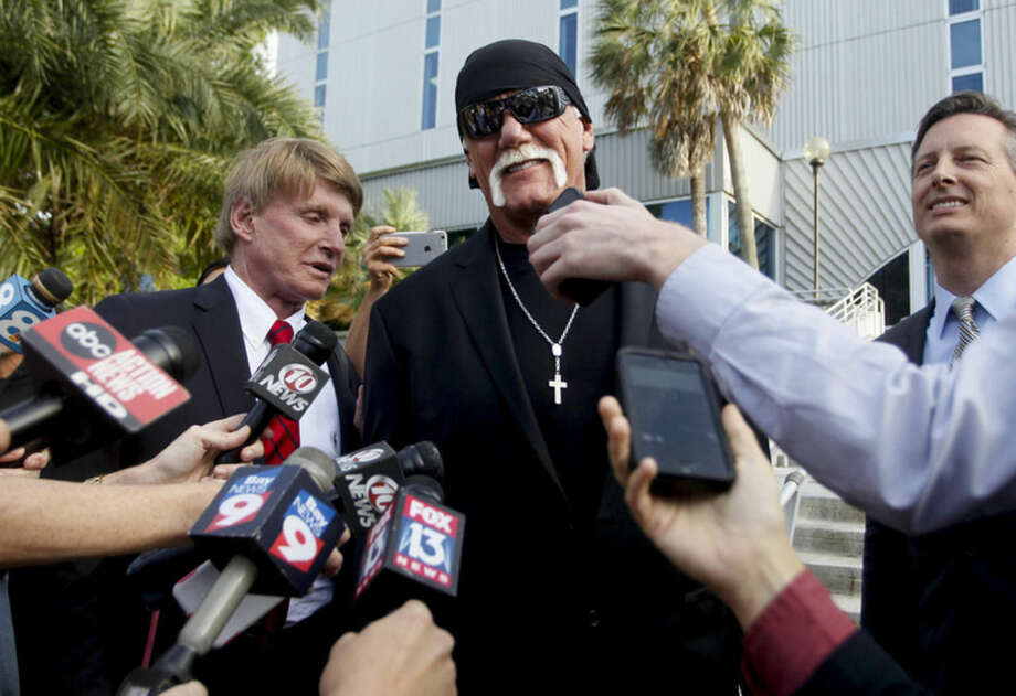 Hulk Hogan, whose given name is Terry Bollea, speaks to the media after a jury returned its decision Monday, March 21, 2016, in St. Petersburg, Fla. A jury has hit Gawker Media with $15 million in punitive damages and its owner with $10 million, adding to the $115 million it awarded last week for publishing a sex video of Hogan. (Dirk Shadd/The Tampa Bay Times via AP) TAMPA OUT; CITRUS COUNTY OUT; PORT CHARLOTTE OUT; BROOKSVILLE HERNANDO TODAY OUT; MANDATORY CREDIT