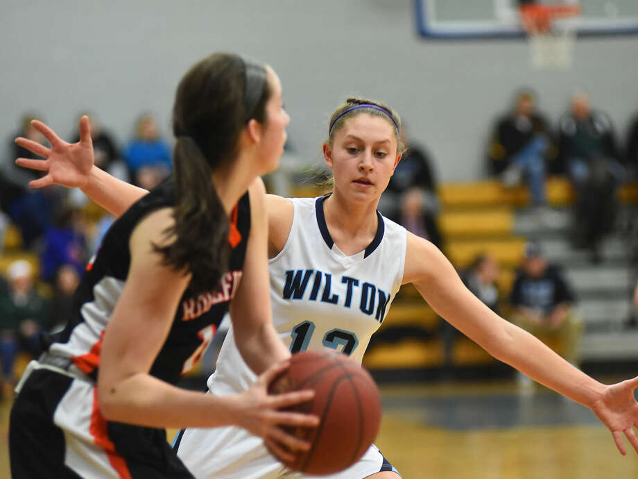 Wilton's Makenna Pearsall guards a Ridgefield Tiger during Tuesday's FCIAC semifinals.
