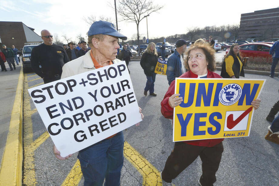 Hour Photo/Alex von Kleydorff Workers gather and rally for better wages, benefits and respect for Union Local 371 Stop & Shop workers at the Main Ave. Norwalk location