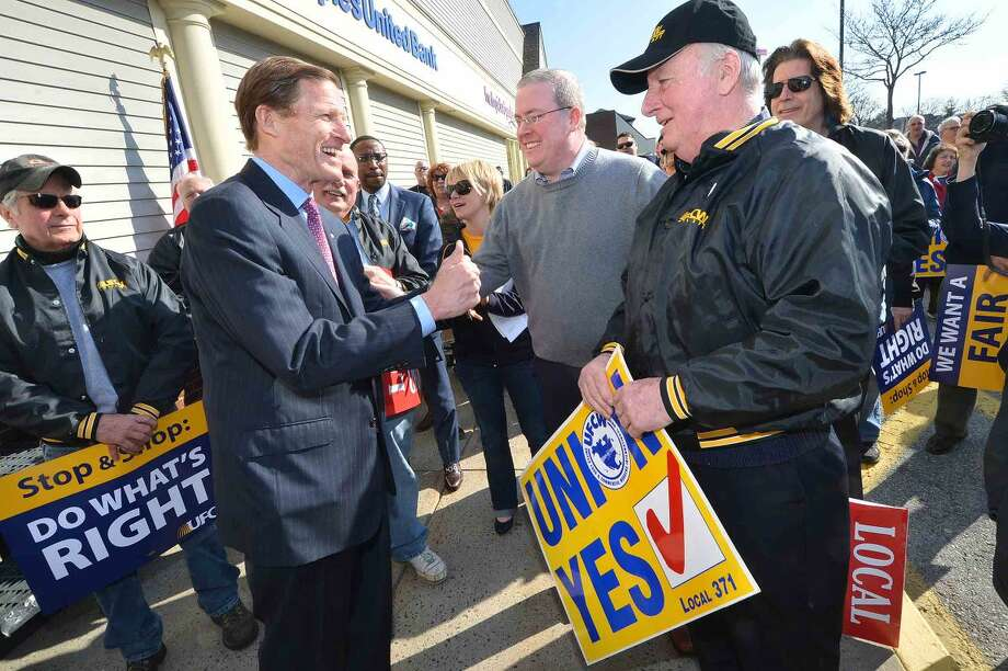 Hour Photo/Alex von Kleydorff US. Senator Richard Blumenthal fires up the crowd and talks with Thomas C. McCarthy and his father Ed McCarthy a 54 yr veteran of Local 371 as a meat cutter, during a rally for better wages, benefits and respect for Stop & Shop workers at the Main Ave. Norwalk location