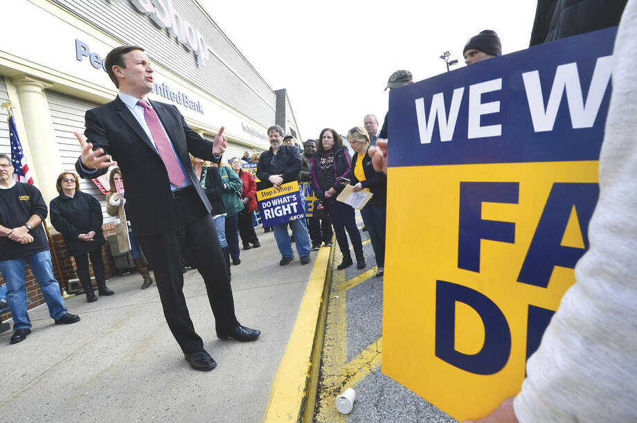 Hour Photo/Alex von KleydorffUS Senator Chris Murphy adresses the crowd during a rally for better wages, benefits and respect for Union Local 371 Stop & Shop workers at the Main Ave. Norwalk location.