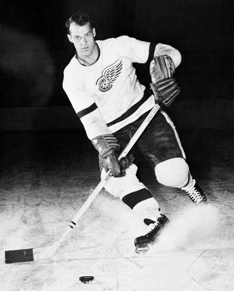 "FILE - This is a 1956 file photo showing Detroit Red Wings hockey player Gordie Howe. Gordie Howe, the hockey great who set scoring records that stood for decades, has died. He was 88. Son Murray Howe confirmed the death Friday, June 10, 2016, texting to The Associated Press: ""Mr Hockey left peacefully, beautifully, and w no regrets.""(AP Photo/File) Photo: STF / 1956 AP"