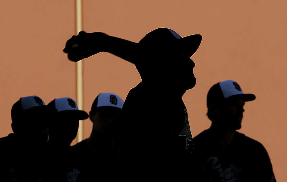 San Diego Padres' Odrisamer Despaigne throws during spring training baseball practice Tuesday, Feb. 24, 2015, in Peoria, Ariz. (AP Photo/Charlie Riedel)