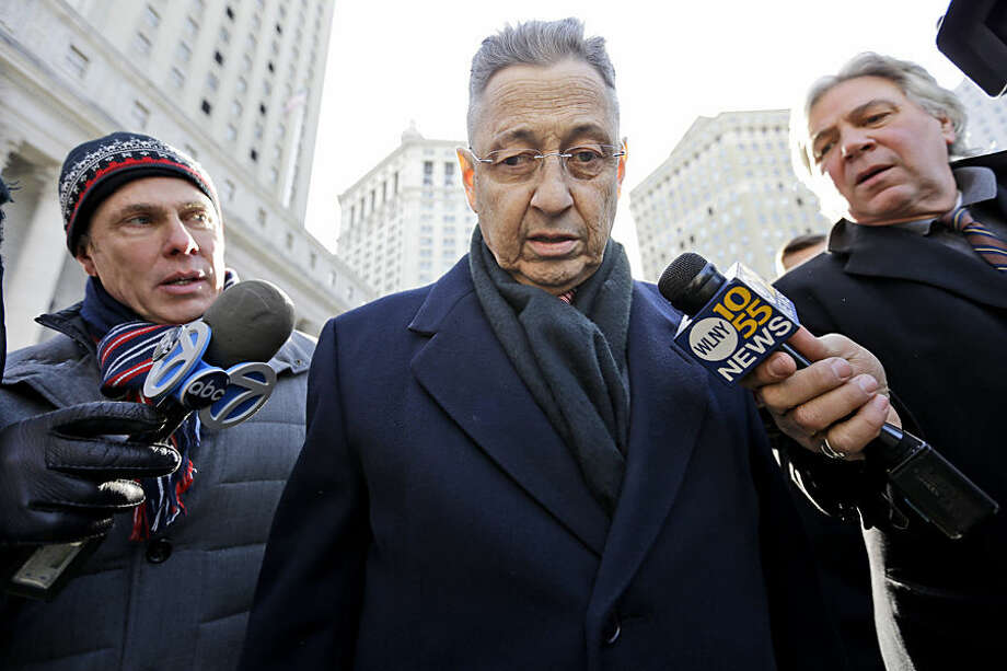 Former New York State Assembly Speaker Sheldon Silver, center, is surrounded by members of the media as he leaves a federal courthouse in New York, Tuesday, Feb. 24, 2015. Silver faces arraignment on bribery charges that spurred his resignation from his role as one of New York's foremost political powerbrokers. (AP Photo/Mary Altaffer)