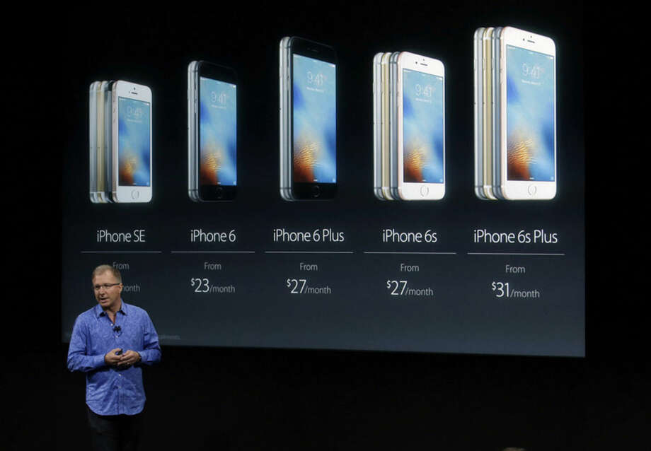 Greg Joswiak, vice president of iOS, iPad and iPhone product marketing, announces the new iPhone SE at Apple headquarters Monday, March 21, 2016, in Cupertino, Calif. (AP Photo/Marcio Jose Sanchez)