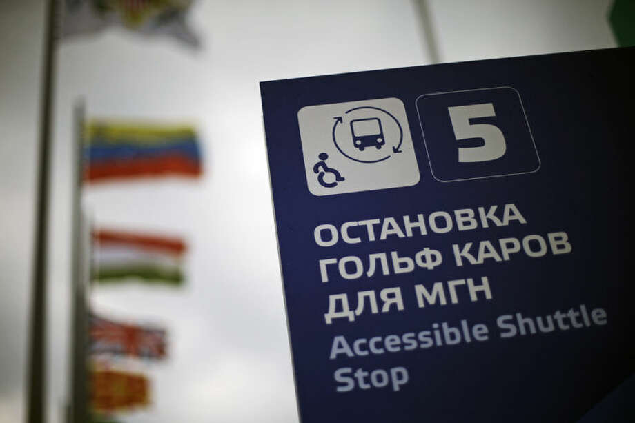 A sign indicating a shuttle stop for people with disabilities stands in Olympic Park in Sochi, Russia, at the 2014 Winter Olympics on Tuesday, Feb. 18, 2014. Some wheelchair-bound passengers have found that bus drivers frequently don't know how to use the lifts, forcing them to either demonstrate themselves or wait for another bus. But Olympic organizers say the drivers will be trained and ready when the Paralympics begin in less than three weeks. (AP Photo/David Goldman)