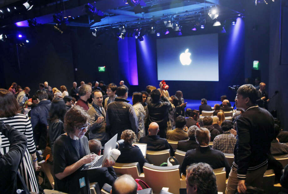 Media and invited guests wait for the start of an event to announce new products at Apple headquarters, Monday, March 21, 2016, in Cupertino, Calif. (AP Photo/Marcio Jose Sanchez)
