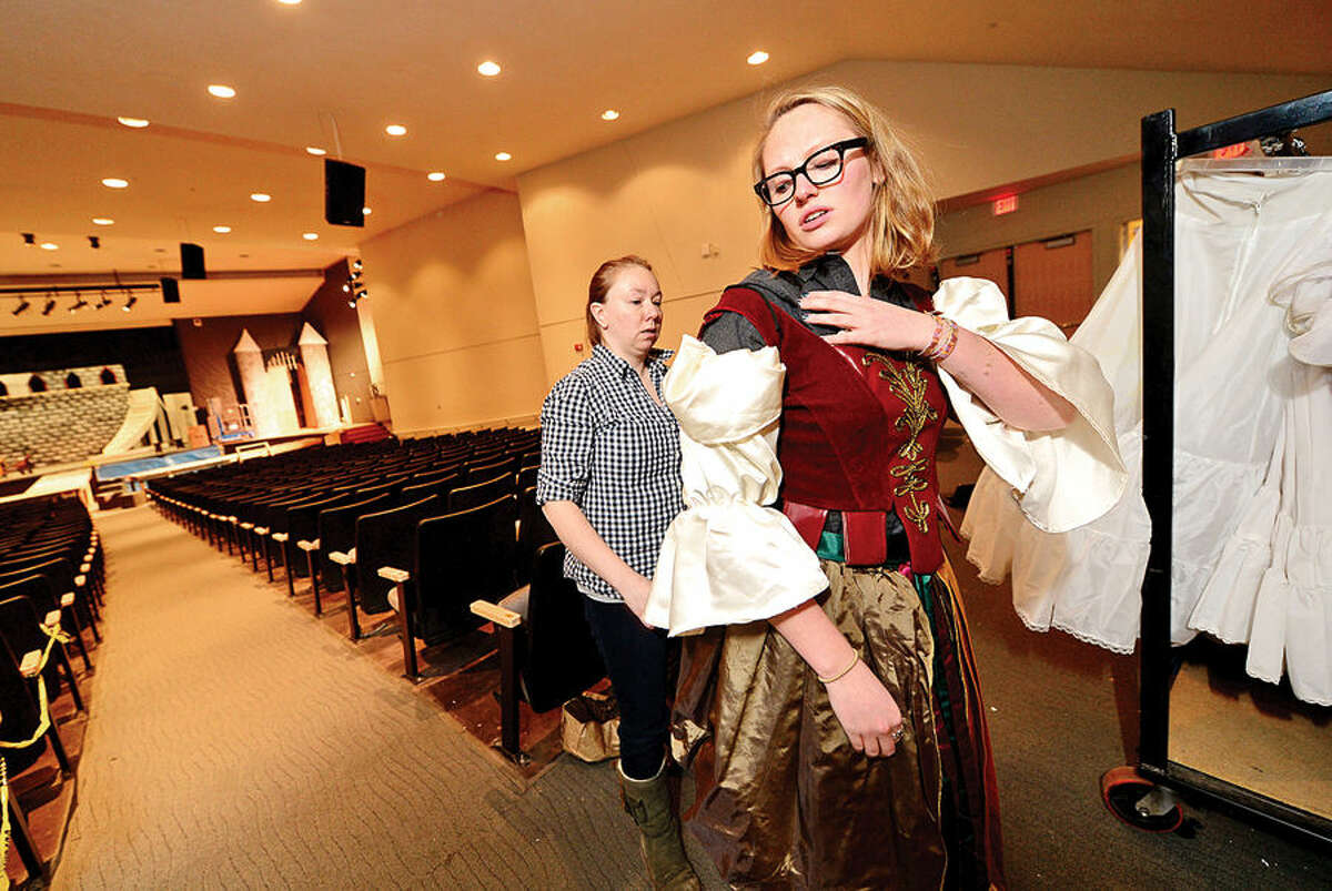 Hour photo / Erik Trautmann Brien McMahon High Schoolactor Molly Hussey tries on her costume for Silly Girl #1 for their production of Beauty and Beast which opens next week.