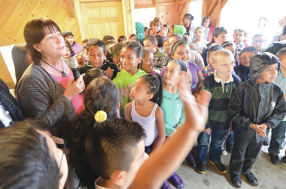 Hour photos / Alex von KleydorffSilvermine Art Center Executive Director Leslee Asch welcomes the students from Brookside School to the reception at Fodor Farm for the installation of their sculptures Monday.