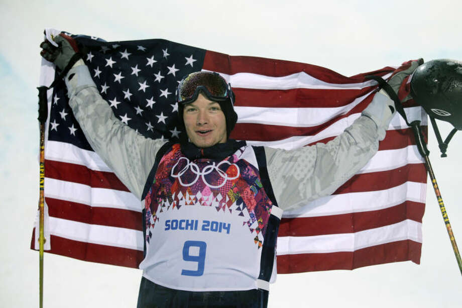 David Wise, of the United States, celebrates after winning a gold medal in the men's ski halfpipe final at the Rosa Khutor Extreme Park, at the 2014 Winter Olympics, Tuesday, Feb. 18, 2014, in Krasnaya Polyana, Russia. (AP Photo/Jae C. Hong)