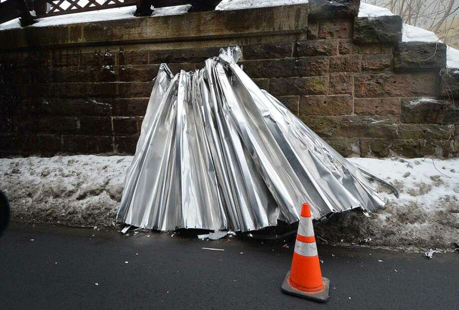 Hour Photo/Alex von Kleydorff The roof of a box truck sheared off under the Saugatuck Ave railroad bridge in Westport