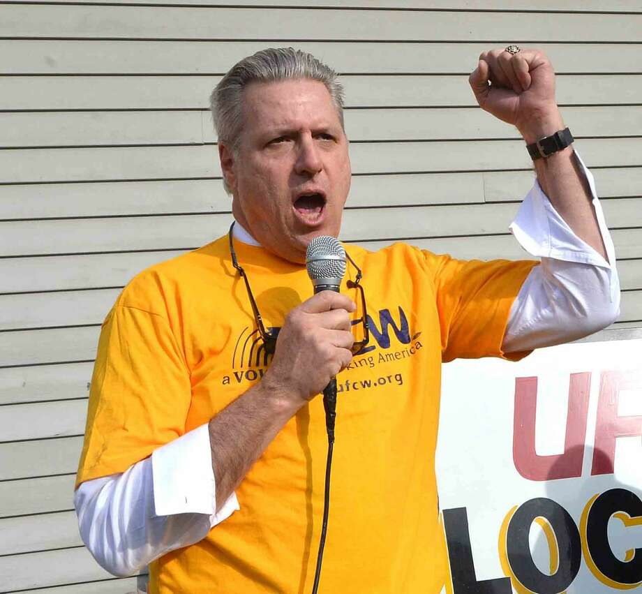 Hour Photo/Alex von Kleydorff Local 371 Union Secretary and Treasurer Ron Petronella speaks during rally for better wages, benefits and respect for Union Local 371 Stop & Shop workers at the Main Ave. Norwalk location