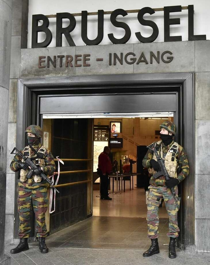 Police secures the central station in Brussels, Wednesday, March 23, 2016. Bombs exploded yesterday at the Brussels airport and one of the city's metro stations Tuesday, killing and wounding scores of people, as a European capital was again locked down amid heightened security threats. (AP Photo/Martin Meissner)