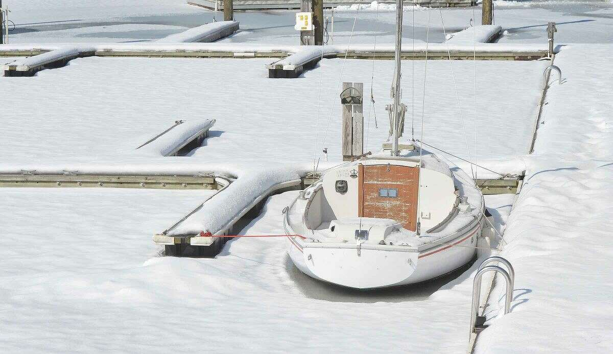 Hour Photo/Alex von Kleydorff A sailboat is frozen at the dock along the Norwalk River on Wedesday