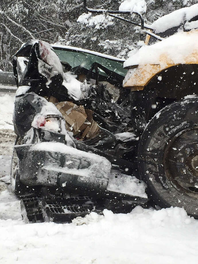 In this photo provided by Maine State Police And Maine Emergency Management, a mangled vehicle from a multi vehicle pileup sits along Interstate 95 in Etna, Maine, about 20 miles west of Bangor, Wednesday, Feb. 25, 2015. State police spokesman Steve McCausland said the pileup happened early Wednesday in heavy snow and involved many cars, a school bus and a tractor trailer. No fatalities were immediately reported but McCausland said some of the injuries were serious. (AP Photo/Maine State Police And Maine Emergency Management, Stephen McCausland)