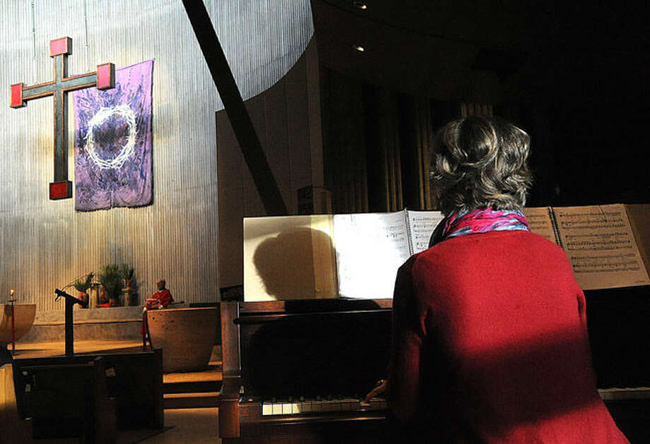 St. Phillip Church in Norwalk has it's Palm Sunday service. Hour photo/Matthew Vinci