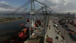 The new super post-Panamax cranes operates at the Houston port on Friday, Nov. 6, 2015, in LaPorte. The larger renovation to the terminal is to handle increases in container trade, and in anticipation of larger ships coming through the Panama Canal after it completes its expansion next year.  ( Elizabeth Conley / Houston Chronicle )