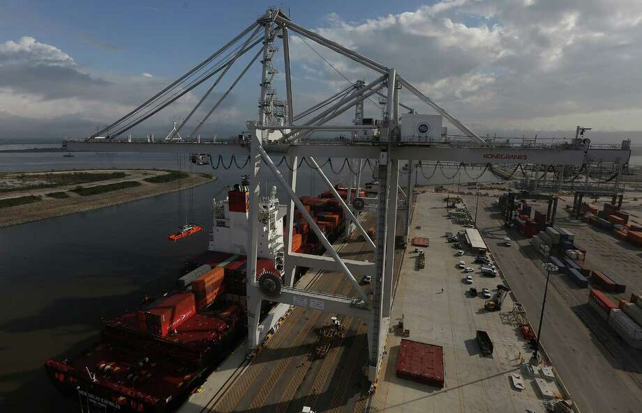 The new super post-Panamax cranes operates at the Houston port on Friday, Nov. 6, 2015, in LaPorte. The larger renovation to the terminal is to handle increases in container trade, and in anticipation of larger ships coming through the Panama Canal after it completes its expansion next year.  ( Elizabeth Conley / Houston Chronicle ) Photo: Elizabeth Conley, Staff / © 2015 Houston Chronicle