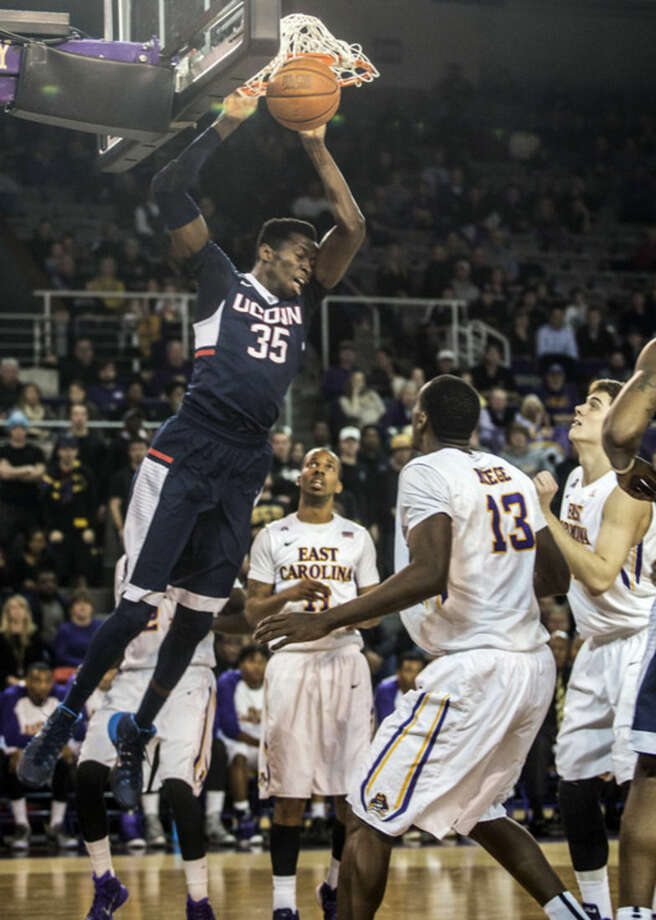 University of Connecticut's Amida Brimah(35) dunks as East Carolina's Michel-Ofik Nzege (13) watches during the first half of an NCAA college basketball game, Wednesday, Feb. 25, 2015, in Greenville, N.C. (AP Photo/The Daily Reflector, Joe Pellegrino)