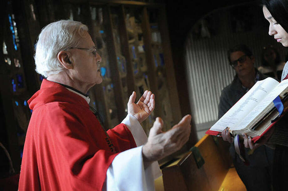 Father Michael Boccaccio leads the Palm Sunday service in Norwalk at St. Phillip Church. Hour photo/Matthew Vinci