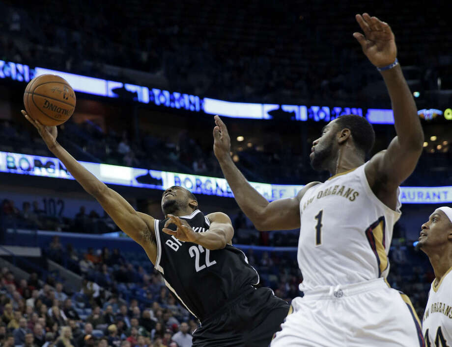 Brooklyn Nets guard Markel Brown (22) goes to the basket in front of New Orleans Pelicans guard Tyreke Evans (1) in the first half of an NBA basketball game in New Orleans, Wednesday, Feb. 25, 2015. (AP Photo/Gerald Herbert)