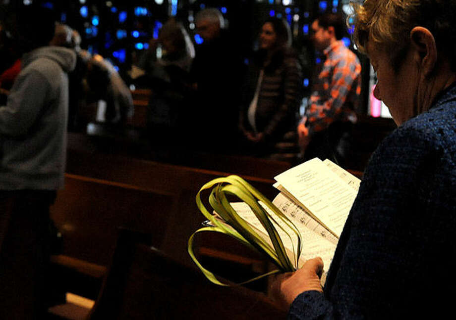 St. Phillip Church in Norwalk has it's Palm Sunday service. Hour photo/Matthew Vinci