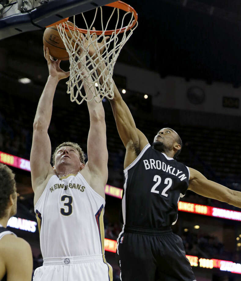 New Orleans Pelicans center Omer Asik (3) and Brooklyn Nets guard Markel Brown (22) battle under the basket in the first half of an NBA basketball game in New Orleans, Wednesday, Feb. 25, 2015. (AP Photo/Gerald Herbert)
