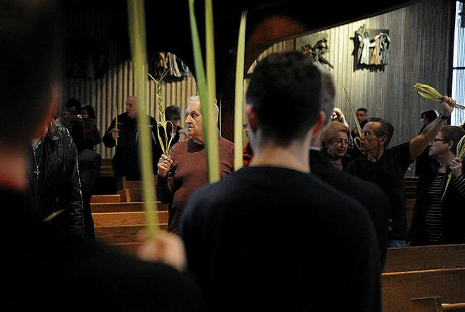 St. Phillip Church in Norwalk observes the Palm Sunday service. Hour photo/Matthew Vinci