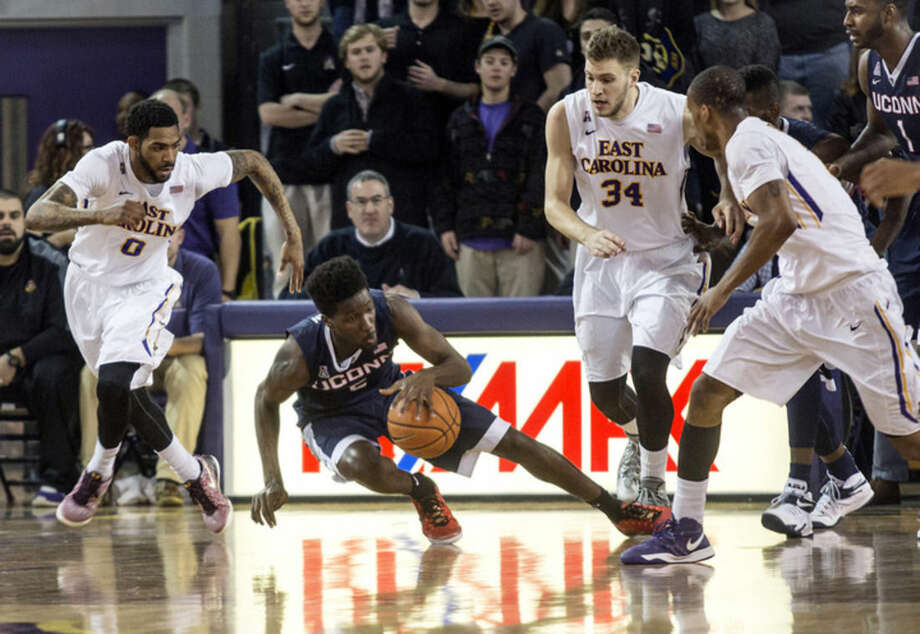 University of Connecticut guard Daniel Hamilton (5) strains to retain control of the ball as Eastern Carolina's Terry Whisnant (0) and Michael Zangari (34) defend during the first half of the NCAA college basketball game, Wednesday, Feb. 25, 2015, at Minges Coliseum in Greenville, N.C. (AP Photo/The Daily Reflector, Joe Pellegrino)