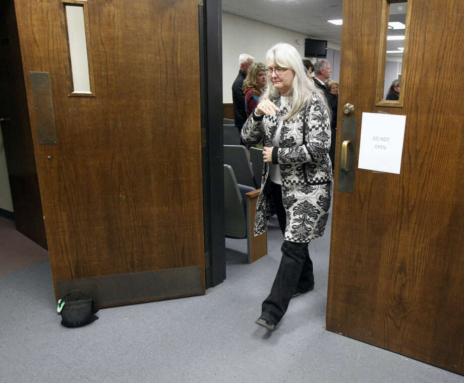 Deby Kyle, mother of Chris Kyle, leaves court after the capital murder trial of former Marine Cpl. Eddie Ray Routh at the Erath County, Donald R. Jones Justice Center in Stephenville, Texas, on Tuesday, Feb. 24, 2015. Routh, 27, of Lancaster, was convicted of the 2013 deaths of Chris Kyle and his friend Chad Littlefield at a shooting range near Glen Rose, Texas. (AP Photo/The Dallas Morning News, Michael Ainsworth, Pool)