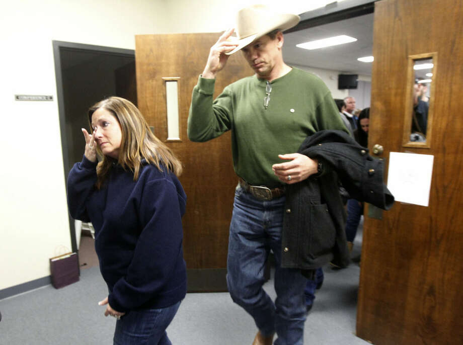 Jay Novacek ,right, and other supporters of the Kyle family leave after the capital murder trial of former Marine Cpl. Eddie Ray Routh at the Erath County, Donald R. Jones Justice Center in Stephenville, Texas, on Tuesday, Feb. 24, 2015. Routh, 27, of Lancaster, was convicted of the 2013 deaths of Chris Kyle and his friend Chad Littlefield at a shooting range near Glen Rose, Texas. (AP Photo/The Dallas Morning News, Michael Ainsworth, Pool)