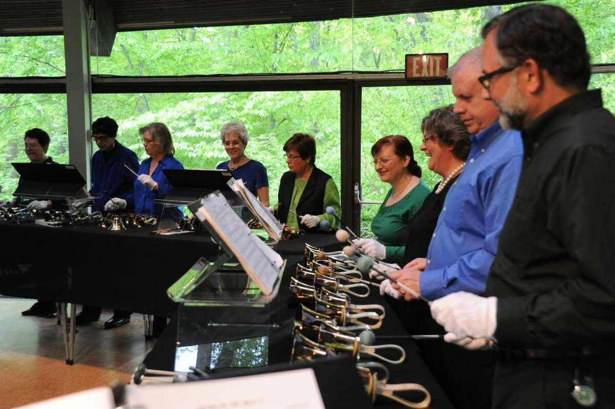 Members of the Jubilate Ringers with Artistic Director David H. Connell (front)in concert at the Unitarian Church in Westport in 2013. The ringers will perform Dr. Connell's suite of Irish dances arranged for handbells as part of Music on the Hill's