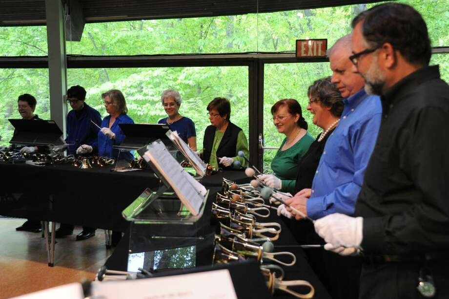 "Members of the Jubilate Ringers with Artistic Director David H. Connell (front) in concert at the Unitarian Church in Westport in 2013. The ringers will perform Dr. Connell's suite of Irish dances arranged for handbells as part of Music on the Hill's ""Luck o' the Irish"" concert on March 15."