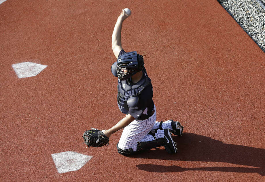 New York Yankees catcher Gary Sanchez catches for pitcher Masahiro Tanaka in the bullpen during a spring training baseball workout, Thursday, Feb. 26, 2015, in Tampa, Fla. (AP Photo/Lynne Sladky)