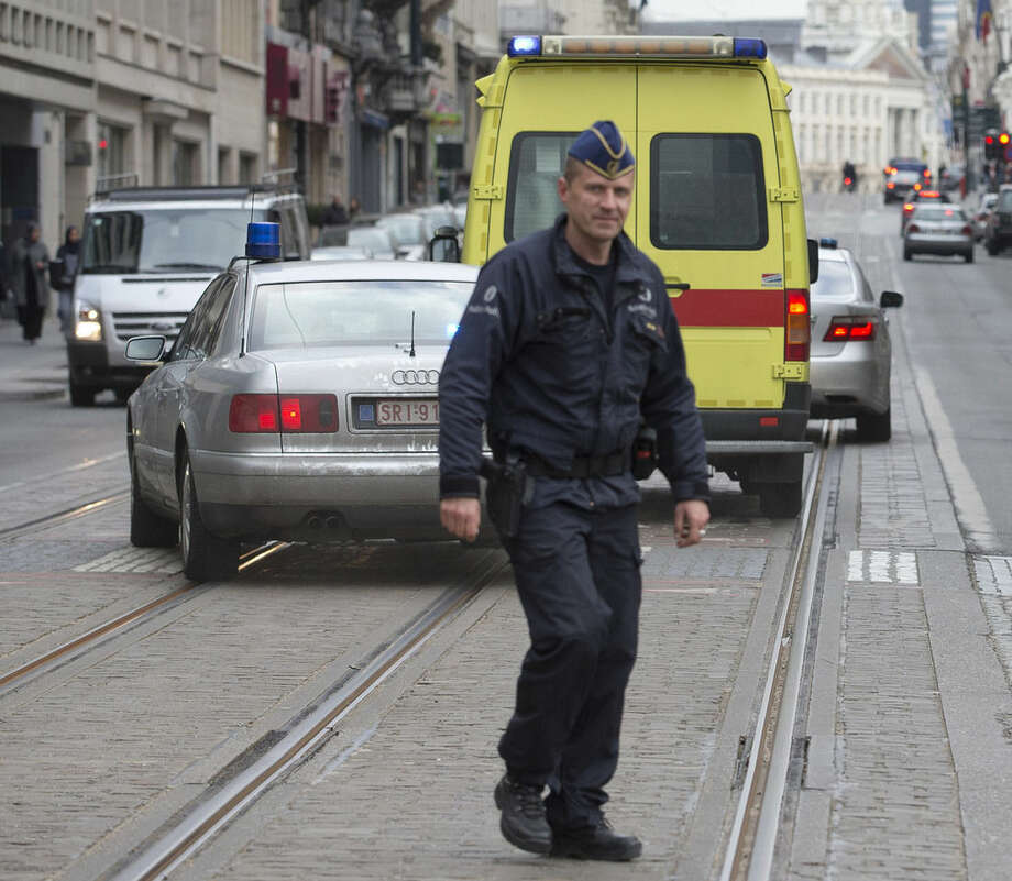 A police convoy thought to be carrying captured fugitive Salah Abdeslam leaves the federal police headquarters in Brussels, Belgium, Saturday, March 19, 2016. Abdeslam, the top suspect in last year's deadly Paris attacks, was arrested after a four-month manhunt with a suspected accomplice and both men have been discharged from a hospital in Brussels and will now face official questioning and a fast-track extradition effort. Abdeslam and his companion were injured when they were captured by police. (AP Photo/Peter Dejong)