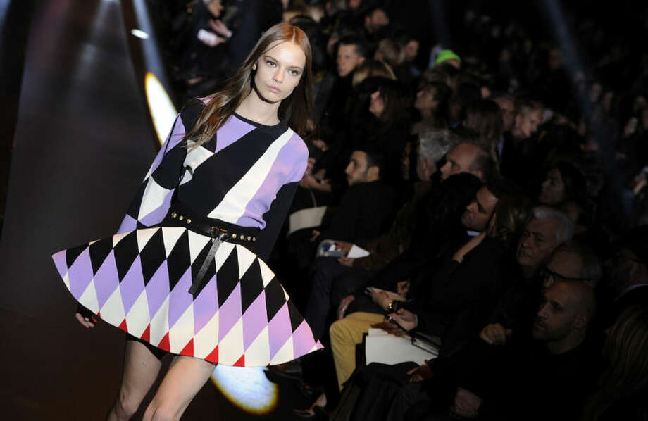 A model wears a creation for Fausto Puglisi women's Fall-Winter 2014-15 collection, part of the Milan Fashion Week, unveiled in Milan, Italy, Wednesday, Feb. 19, 2014. (AP Photo/Giuseppe Aresu)