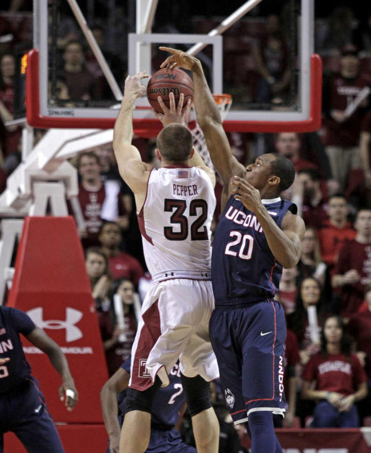Connecticut's Lasan Kromah (20) blocks a shot by Temple's Dalton Pepper (32) in the first half of an NCAA college basketball game, Thursday, Feb. 20, 2014 in Philadelphia. (AP Photo/H. Rumph Jr.)