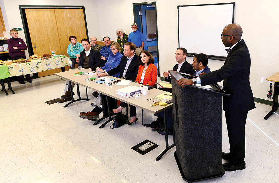 Hour photo / Erik Trautmann Moderator Darnell D. Crosland listens as Norwalk State legislators answer questions and talk about the current legislative session during The League of Women Voters of Norwalk annual Pie and Politics event Saturday, March 19, 2016 in the Norwalk Police Department Community Room.