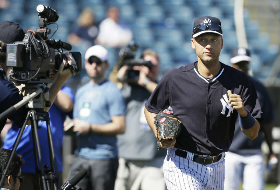 New York Yankees shortstop Derek Jeter runs to the field before a spring training baseball practice Thursday, Feb. 20, 2014, in Tampa, Fla. (AP Photo/Charlie Neibergall)