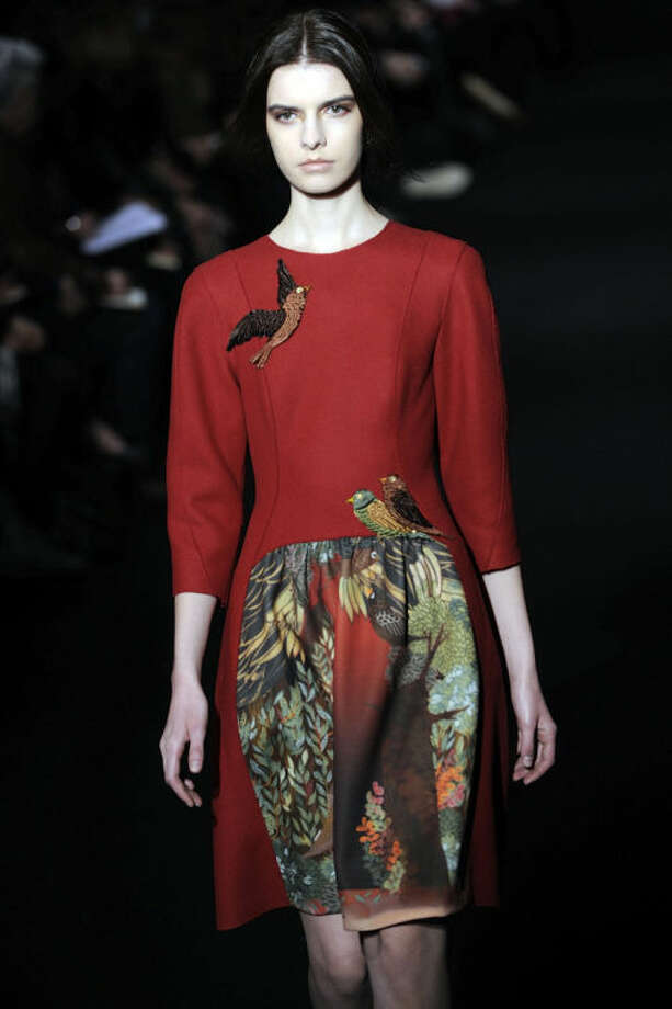 A model wears a creation for Alberta Ferretti women's Fall-Winter 2014-15 collection, part of the Milan Fashion Week, unveiled in Milan, Italy, Wednesday, Feb. 19, 2014. (AP Photo/Giuseppe Aresu)