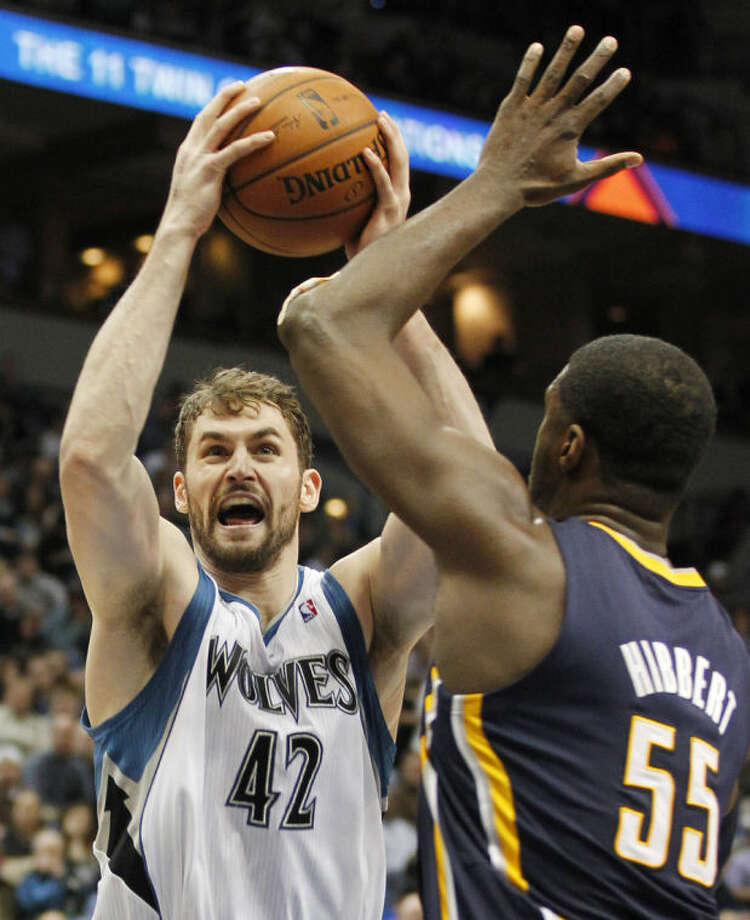 Minnesota Timberwolves forward Kevin Love (42) shoots over Indiana Pacers center Roy Hibbert during the second quarter of an NBA basketball game, Wednesday, Feb. 19, 2014 in Minneapolis. The Timberwolves won 104-91. (AP Photo/Andy Clayton-King)