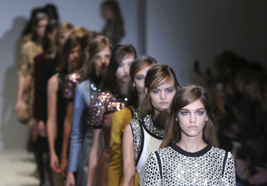 Models wear creations for Gucci women's Fall-Winter 2014-15 collection, part of the Milan Fashion Week, unveiled in Milan, Italy, Wednesday, Feb. 19, 2014. (AP Photo/Antonio Calanni)