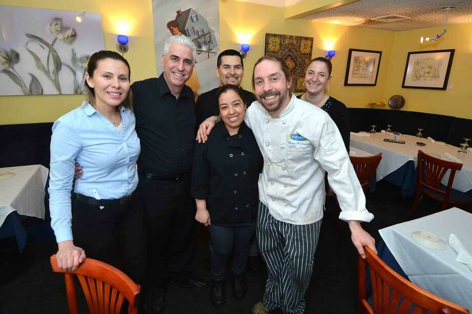 Hour Photo/Alex von Kleydorff Owner Bryan Malcarney surrounded by his staff at Blue Lemon in Westport