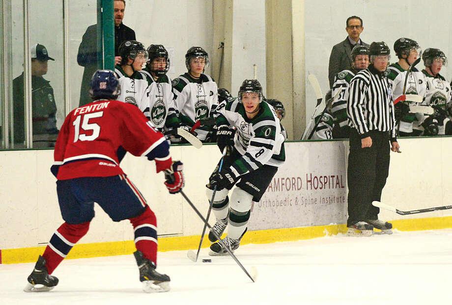 Hour photo / Erik Trautmann Connecticut Oilers battle the Boston Junior Rangers in their EHLplayoff game Thursday at the SoNo Ice House.