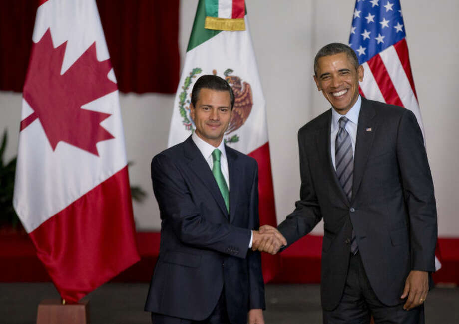 Mexico's President Enrique Pena Nieto, left, and President Barack Obama pose for photographers at the North American Leaders Summit in Toluca, Mexico, Wednesday, Feb. 19, 2014. Obama is in Toluca Wednesday for the one-day summit with Mexican and Canadian leaders, meeting on issues of trade and other neighbor-to-neighbor interests, even as Congress is pushing back against some of his top cross-border agenda items. (AP Photo/Eduardo Verdugo)
